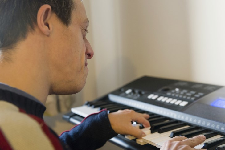 Service User playing keyboard