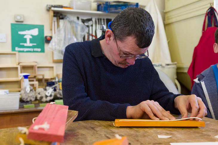 Service-User-in-woodwork